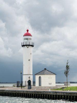 Lighthouse against dark sky of storm clouds in Hellevoetsluis, South Holland, Netherlands